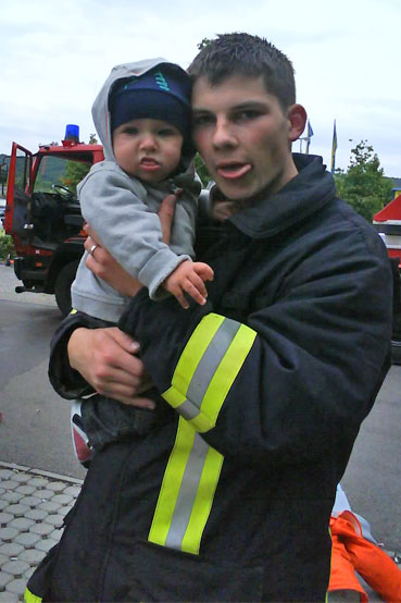I really think Stephan, 22, of Gera is cute. Yeah, he's sticking his tongue out, but that's fine given the context as he's holding a cute baby!